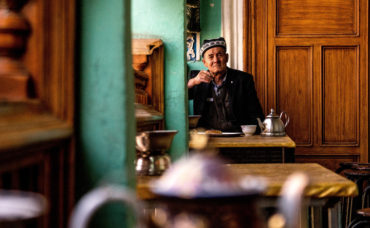 Man drinking tea in tea house