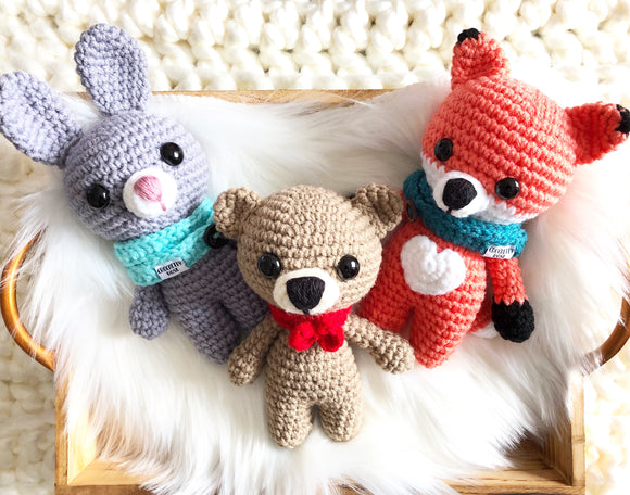 3 handmade stuffed toys. One grey bunny with cowl , one beige bear with bow tie and one orange fox with cowl and a heart shaped white belly. The size of each is 7 in approximately.
