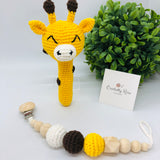 Baby rattle in a giraffe design (yellow, brown and white colours) with a 70 millimetres natural wood ring as a handle in a set with a pacifier dummy clip made with natural wood & crocheted beads in a baby cotton yarn white cord