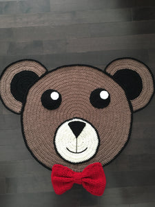 Handmade bear rug with acrylic yarn. Colours brown, black and cream with red bow. Size 34 x 25 in approx.