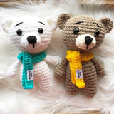 One 7 inch polar bear stuffed toy with blue scarf and one beige bear teddy with yellow scarf.