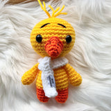 One 7 inch handmade yellow duck stuffed toy with white scarf.