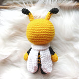 One 7 in bumble bee stuffed stay with white scarf. Back looking.