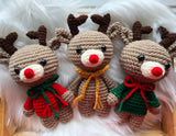 3 Reindeer with holiday's colours. One with red T-shiirt, one without t-shirt and one with green t-shirt. All are handmade stuffed toys with 7 inches approximately tall.