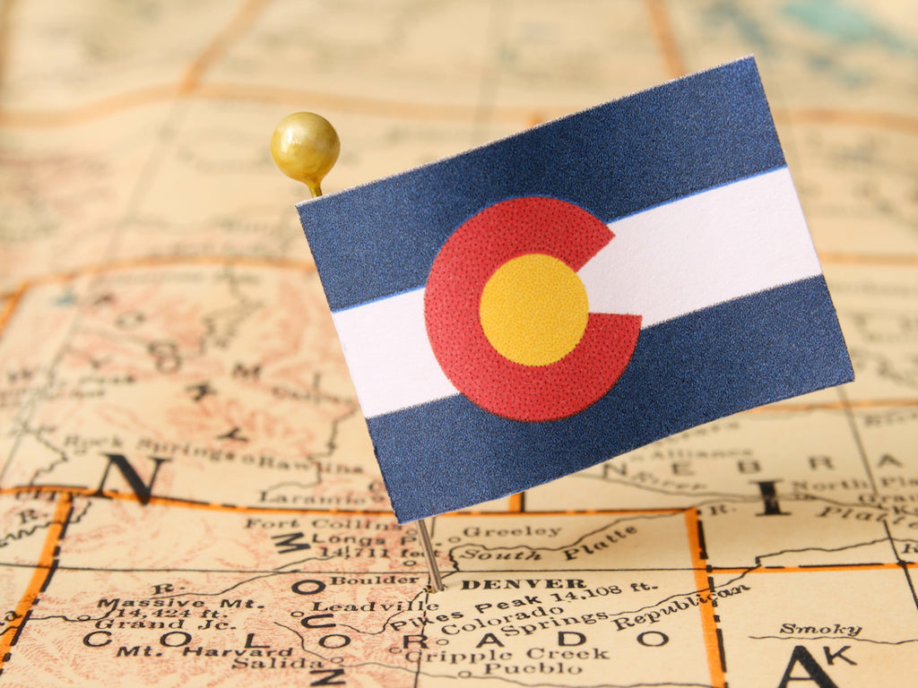 Map pointing to Denver, with Colorado flag pin