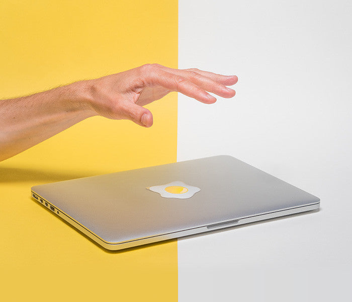 macbook with glowing egg sunny side up tabtag