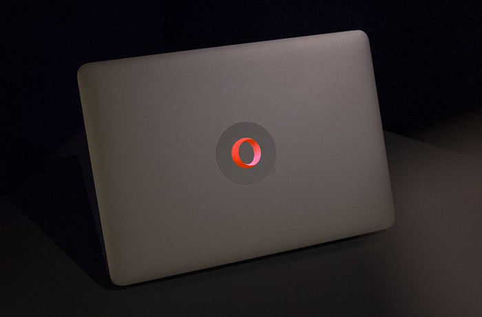 opera macbook sticker glowing on a macbook