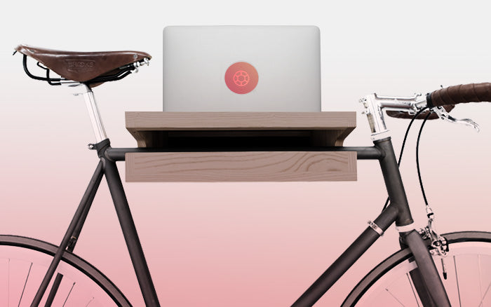 bicycle hanger with a macbook including a glowing decal