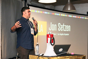 speaker jon setzen with custom tabtag macbook sitcker