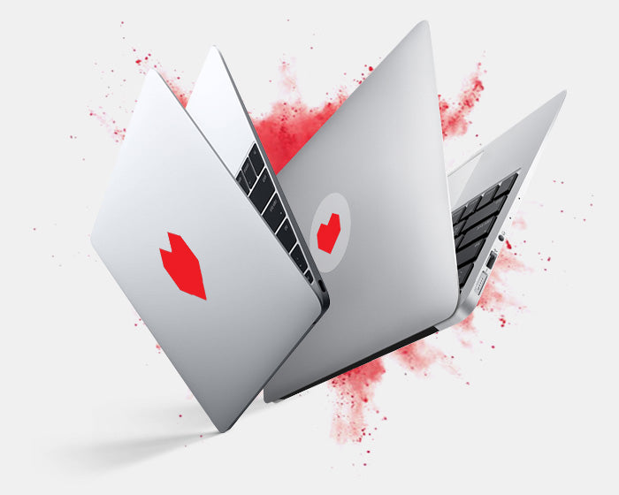 "glwoing and opaque ""hex heart"" tabtag on a macbook"