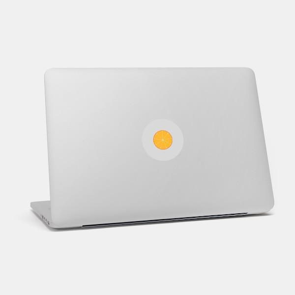 """orange"" macbook sticker glowing on a mac by tabtag"