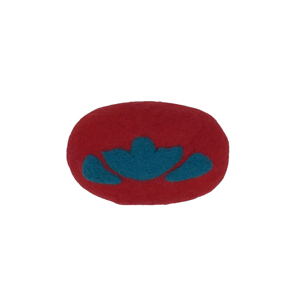 Oval bar of soap covered in wool, red in color with a blue flower like design.