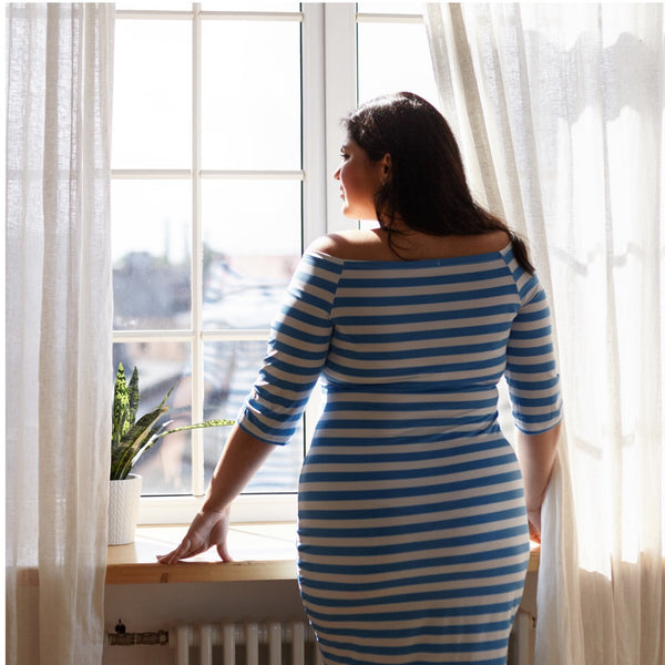 Curvy Girl Looking Out Of A Window