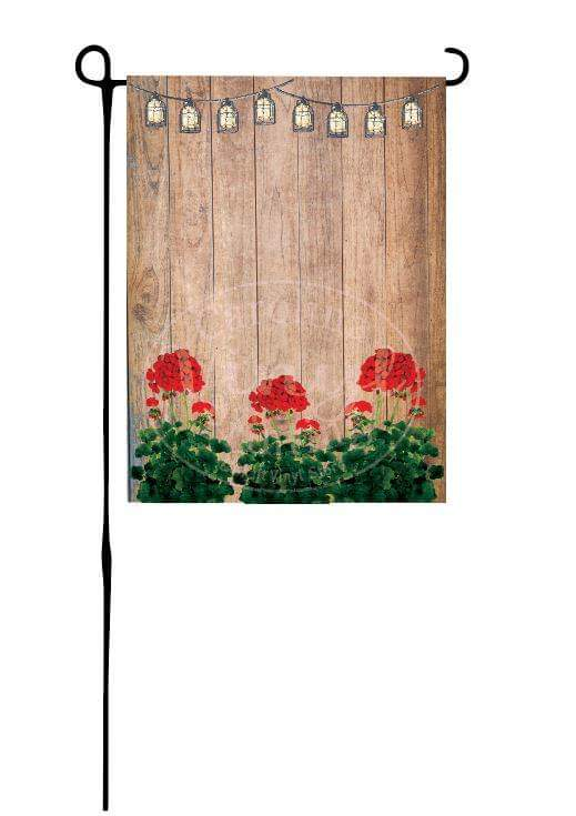 Red Geraniums on wood background