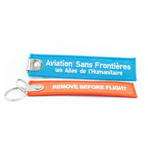 "2 porte-clés flamme Aviation Sans Frontières ""REMOVE BEFORE FLIGHT"""