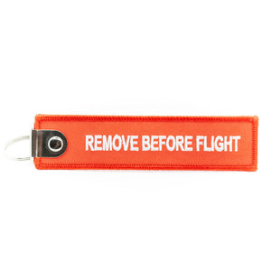 "Porte-clés flamme Aviation Sans Frontières ""REMOVE BEFORE FLIGHT"""