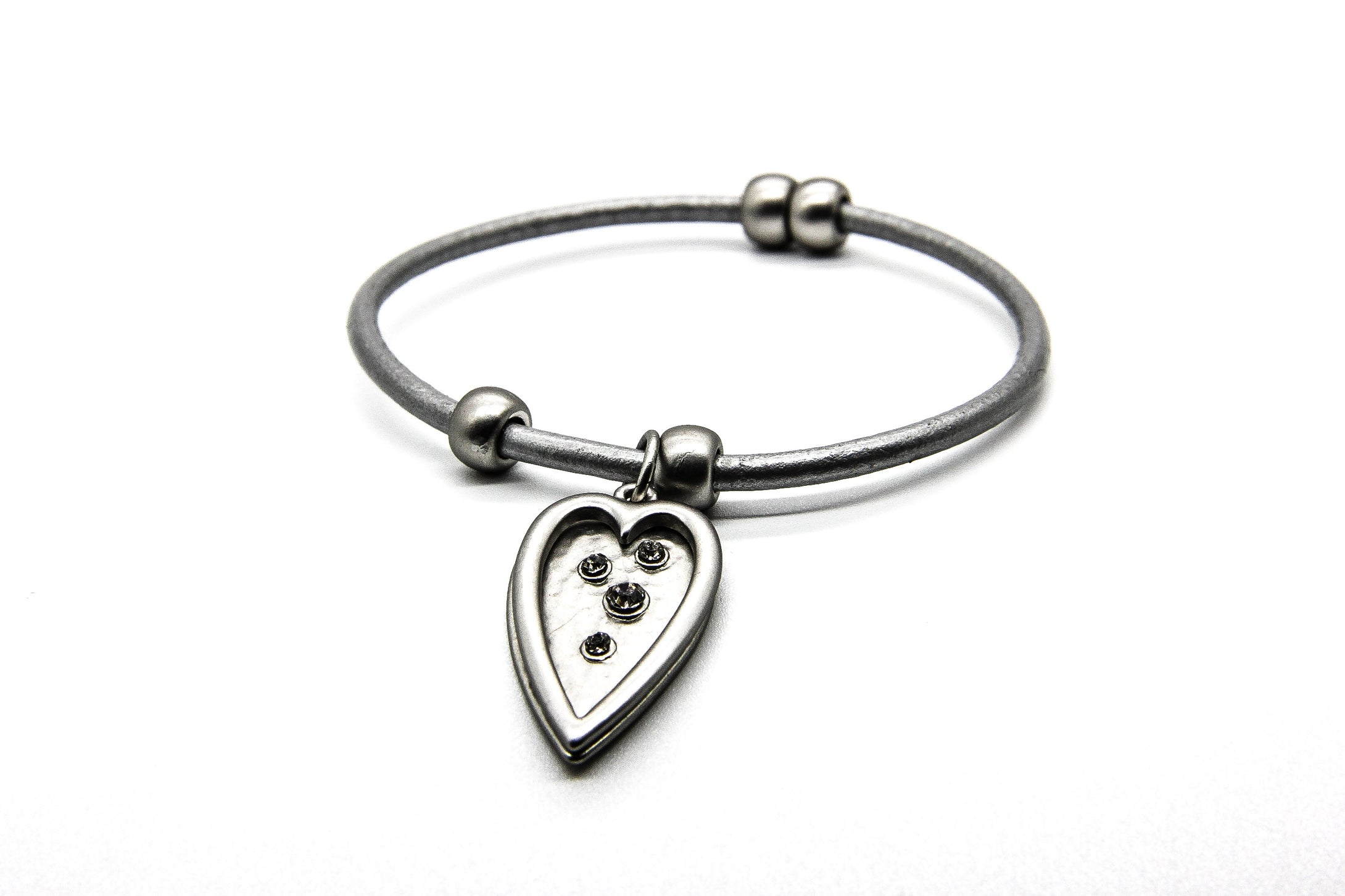 Silver beach bangle with heart shaped dropper encrusted with crystals | Ben's Beach