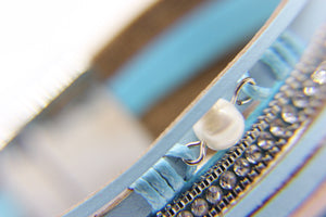 Close up of the pearl feature on a blue multi-strand beach bracelet - Ben's Beach
