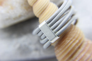 Back of grey multi-strand ring showing metal clasp