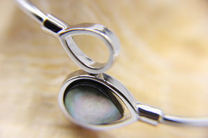 Close-up shot of Scilla silver bangle showing black shell detail - Ben's Beach