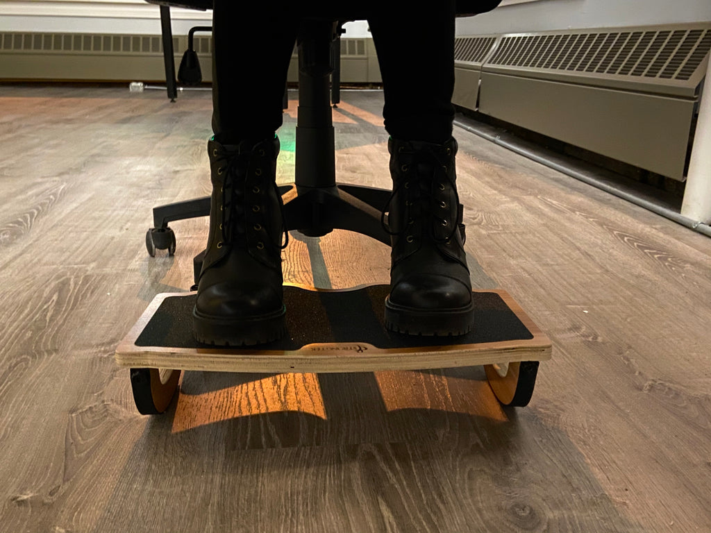 woman using balance board at work