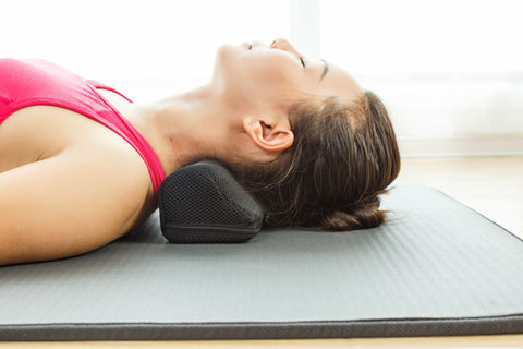 Cushioned neck stretcher for stretching and pain relief