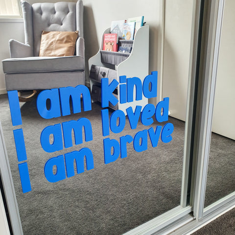 Positive affirmations for children on mirror - blue decal. I am kind, I am loved, I am brave.