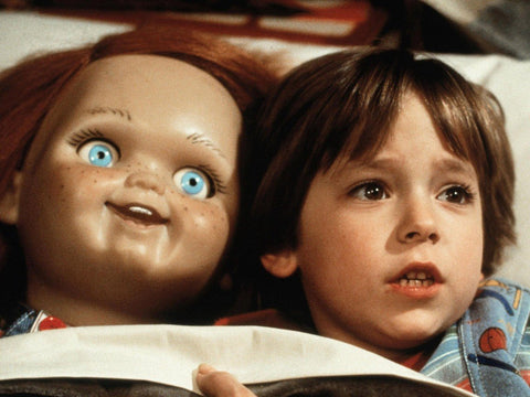 Chucky and Andy reading a book