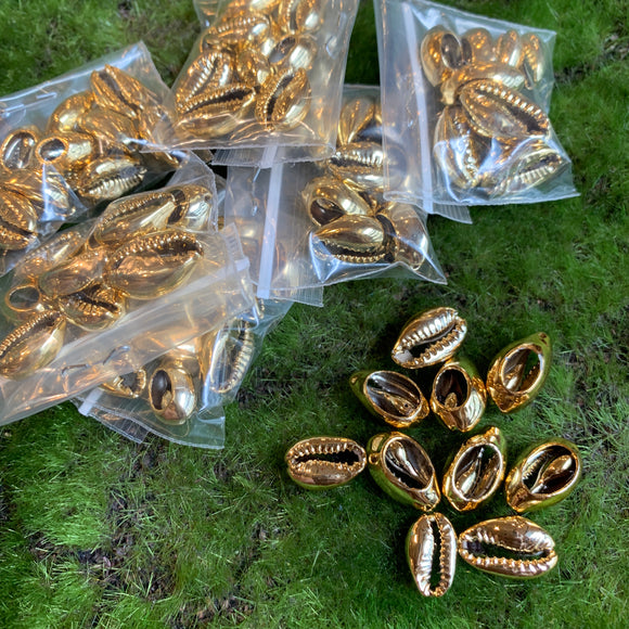 Gold dipped cowrie shells