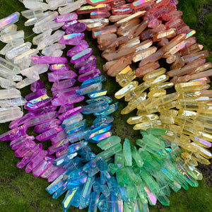 Dyed quartz points in red, orange, yellow, green, blue, purple and iridescent clear