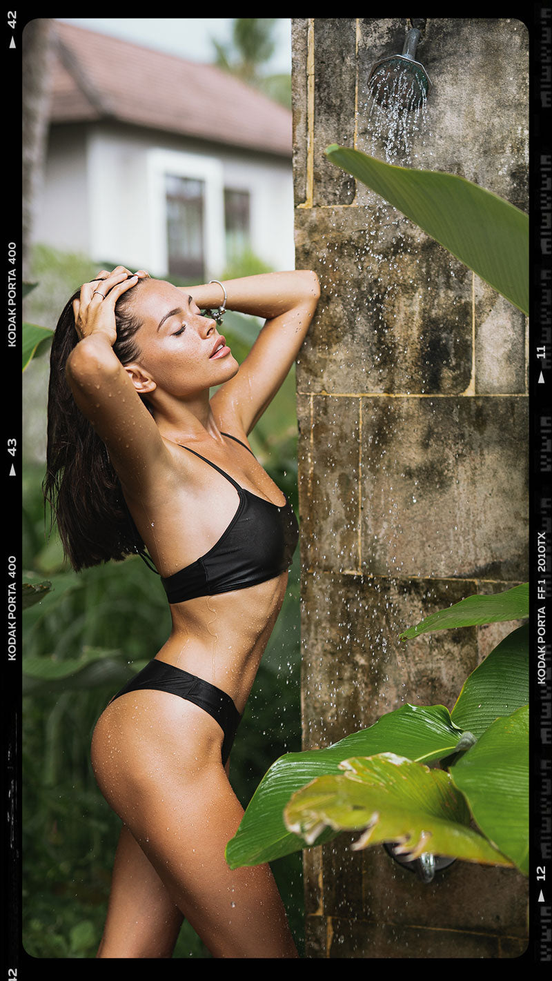 female model posing in tropical outdoor villa in Bali