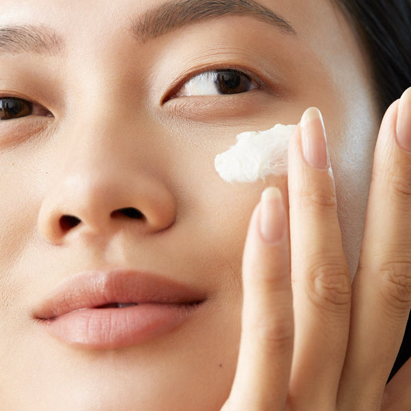 Model applying Brightening Eye Serum