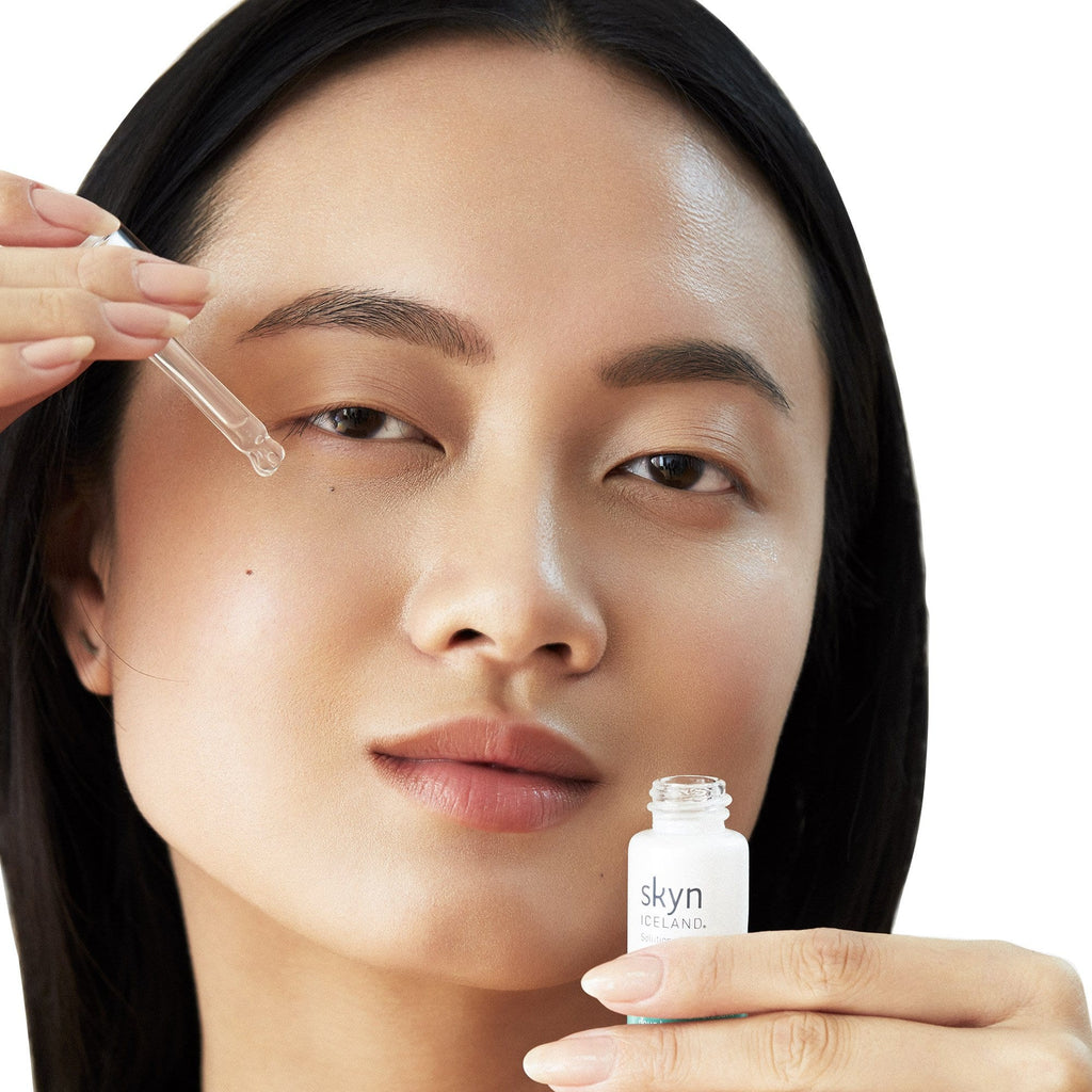 Model holding Brightening Eye Serum