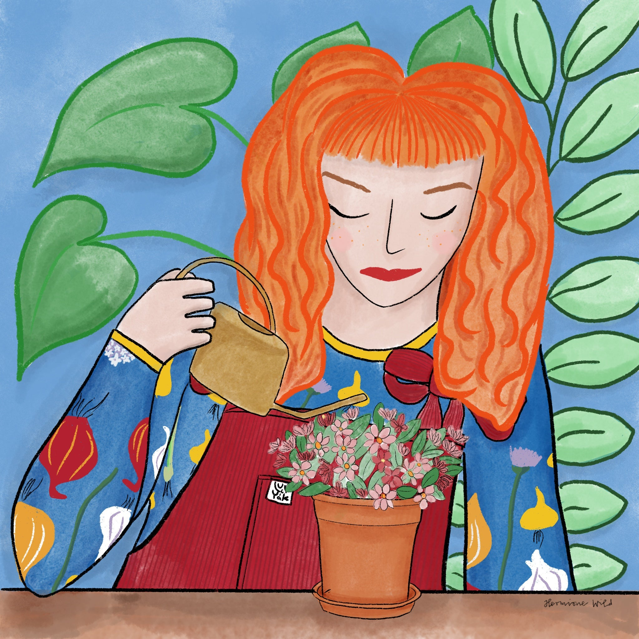 Woman with red hair watering plants wearing dungarees