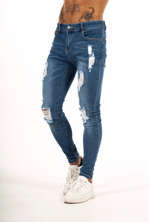 RIPPED AND REPAIRED BLUE JEANS