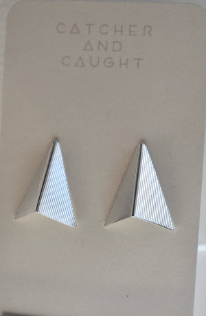 Silver arrow stud earrings, textured.