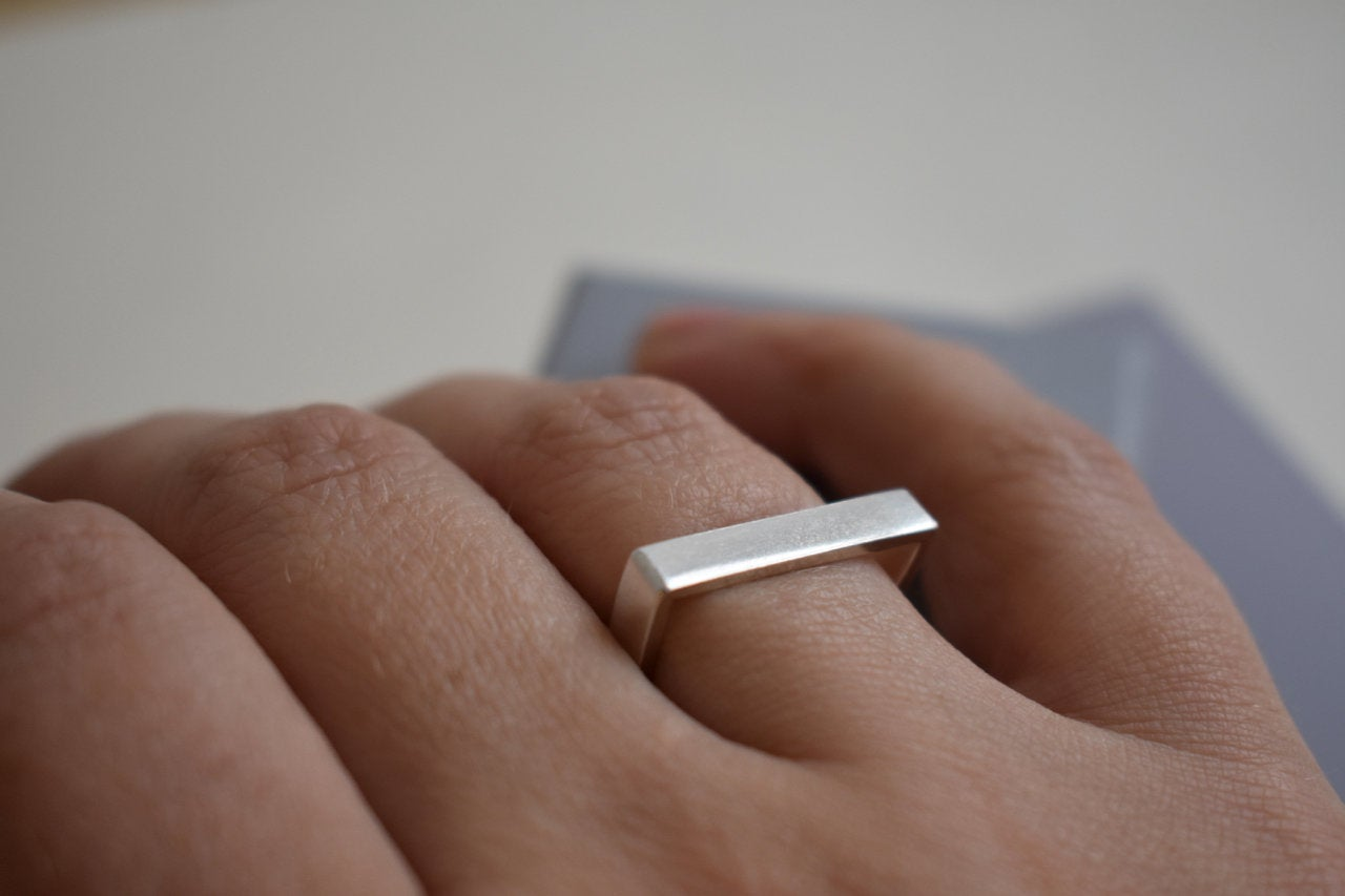 Silver D shaped ring