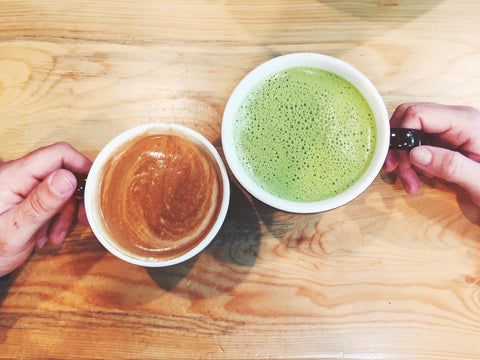 A cup of matcha and a cup of coffee, compared