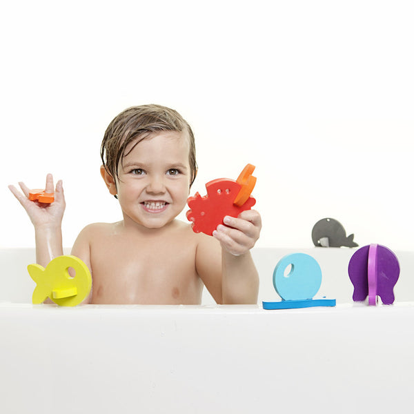 Boy playing with Boon Links bath toys