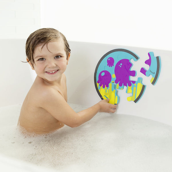 Boy finishing the Pieces bath puzzle