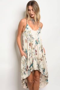 Ladies fashion sleeveless floral print satin slip style dress with a  v- neckline and a hi-low loose fit cut