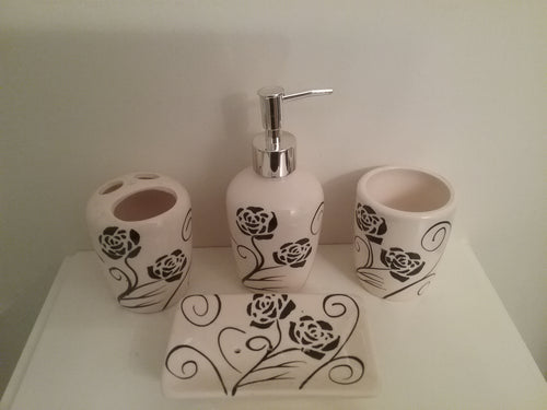 Black And White Bathroom Accessory Set, which includes black flowers on the set.  The set includes a lotion dispenser, toothbrush/toothpaste holder, soap dish and rinse cup
