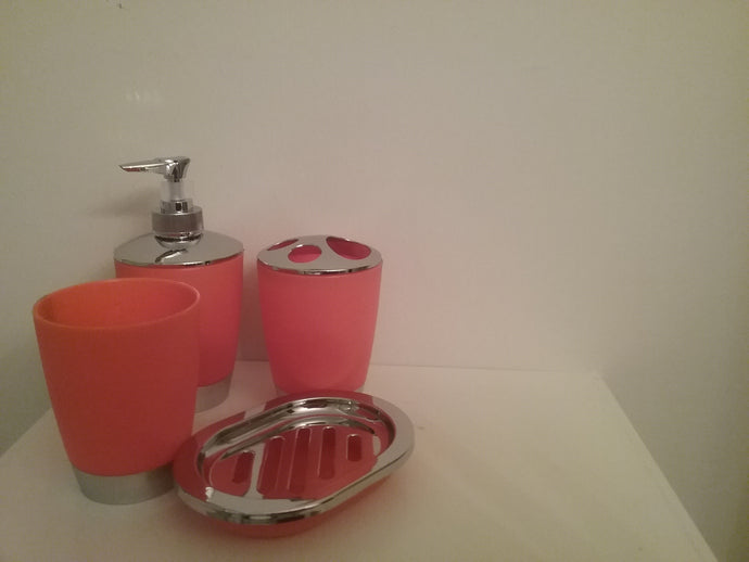 Red Orange and Silver Bathroom Accessory Set - 4 Piece Red Orange and Silver Bathroom Accessory Set, which includes:  Soap Dish, Lotion Dispenser, Rinse Cup and Toothbrush Holder