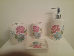 4 Piece Multi-Color Flower Bathroom Accessory Set, which includes:  Soap Dish, Lotion Dispenser, Rinse Cup and Toothbrush Holder