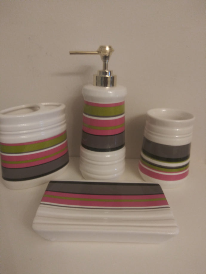 4 piece ceramic bathroom accessory set with pea green, pink, dark gray, black stripes.  The set includes:  soap dish, rinse cup, toothbrush/toothpaste holder and lotion dispenser.