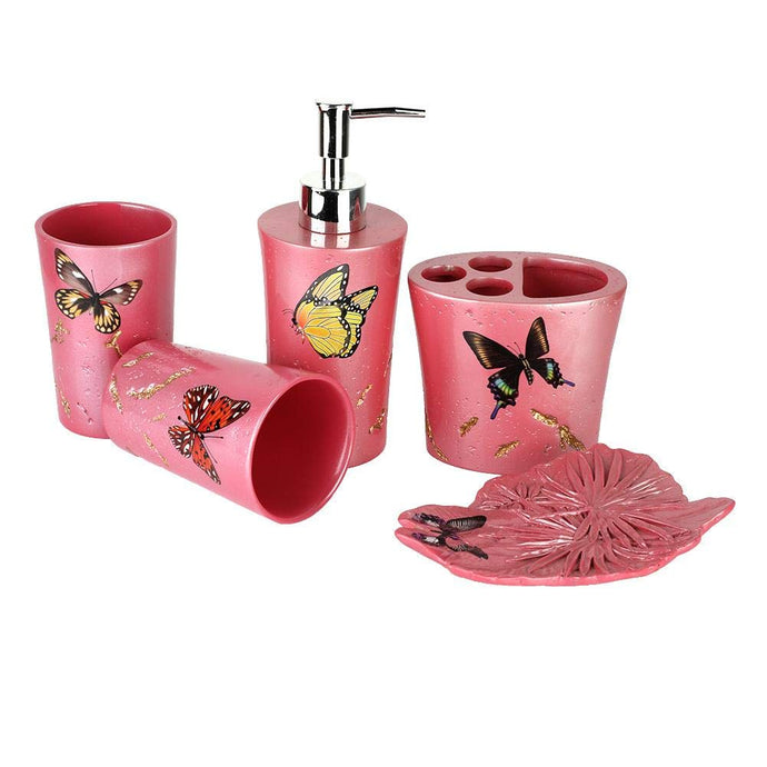 3D Resin 5 Piece Pink With Butterflies Bathroom Accessory Set, which includes:  Lotion Dispenser, Toothbrush Holder, Two Tumblers and Soap Dish