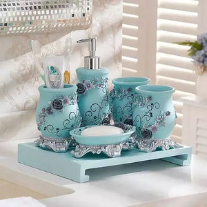 Sky Blue 5 piece resin bathroom accessory set with dark blue roses as vine on the set.  The set includes:  a lotion dispenser, soap dish, two tumblers and a toothbrush/toothpaste holder.