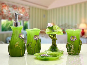 Five Piece lime green artistic design bathroom accessory set.  It includes:  lotion dispenser, soap dish, two tumblers and toothbrush holder.