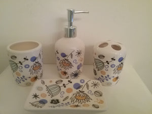 Orange, Black and Blue Bathroom Accessory Set.  The set includes:  lotion dispenser, soap dish, toothbrush holder and tumbler.