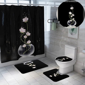 Black Shower Curtain Set.  The sets design is a clear round vase with light pink and white flowers coming out of the vase.  The set includes:  a shower curtain, white shower curtain rings, toilet seat cover, mat for toilet and mat for tub or sink.